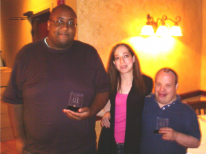 CAREERS clients Greg Mancini (left) and Kenny Austin (right) with Candice Sciarrillo, Carmel Cinema manager. The three gathered at a luncheon with theatre management, who held the celebration to recognize their decade of service.